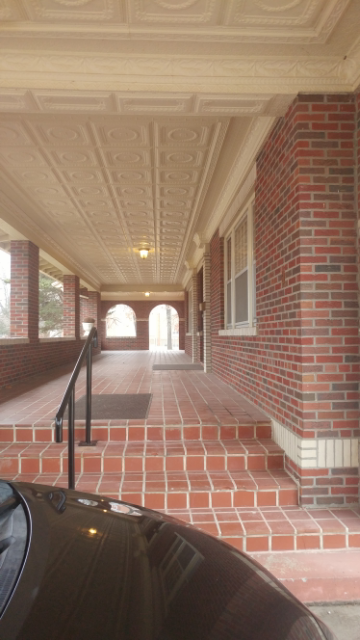 I need this porch in my life. This is a view from the side and toward the front entrance to the Leadership Center