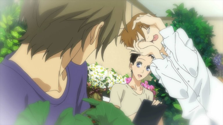 The face-maker is Shimao, departed husband. Rokka can't see him, but Hazuki sure can. Image courtesy losanimesdemagrat.wordpress.com